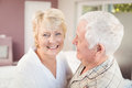 Cheerful senior woman with husband women in nightwear at home Stock Images