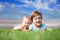 Cheerful sibling plays at grass in summer Stock Photography