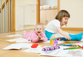 Cheerful sibling plays with pencils in home interior Stock Photos
