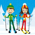 Cheerful skiers in the forest.