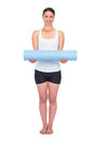 Cheerful slender model posing holding her rolled up mat on white background Stock Image