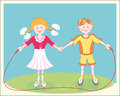 Cheerful smiling children jumping rope.