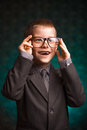 Cheerful smiling pupil on a green background boy Royalty Free Stock Photos