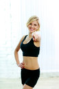 Cheerful sport woman pointing at you young Royalty Free Stock Photo