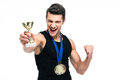 Cheerful sports man holding winner cup Royalty Free Stock Photo