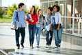 Cheerful students walking on campus full length of university Stock Photography