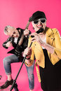 Cheerful stylish senior couple of rock and roll musicians performing Royalty Free Stock Photo
