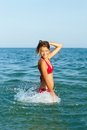 Cheerful teen girl having fun in the sea Royalty Free Stock Images