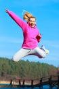 Cheerful teenage girl jumping showing outdoor