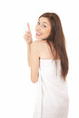 Cheerful teenage girl in towel pointing up Royalty Free Stock Photography