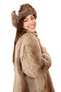 Cheerful teenager girl in fur coat and hat, Stock Photo