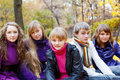 Cheerful teens in the fall Royalty Free Stock Photo
