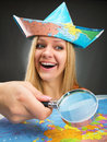 Cheerful traveler girl discovering map with magnifier Royalty Free Stock Images