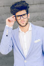 Cheerful trendy guy with black eyeglasses on Royalty Free Stock Photo