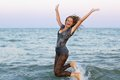 Cheerful wet teen girl having fun in the sea Royalty Free Stock Image