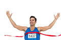 Cheerful winner athlete crossing finish line Royalty Free Stock Photo