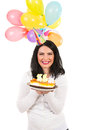 Cheerful woman with birthday cake and balloons isolated on white background Royalty Free Stock Photography