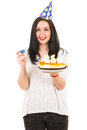 Cheerful woman with birthday cake party hat holding isolated on white background Royalty Free Stock Image