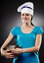 Cheerful woman chef wearing hat and holding a po studio shot of pot over gray background Stock Images