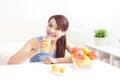 Cheerful woman drinking an orange juice Royalty Free Stock Photo