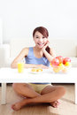 Cheerful woman eat breakfast at home asian beauty Stock Photos