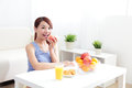 Cheerful woman eat breakfast at home asian beauty Stock Image