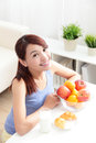 Cheerful woman eat breakfast and sitting on her sofa at home asian beauty Stock Photos
