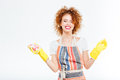 Cheerful woman with foam on curly hair holding yellow rubber Royalty Free Stock Photo