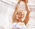 Cheerful woman on hammock Stock Image