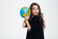 Cheerful woman holding globe and looking at camera Royalty Free Stock Photo