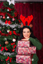 Cheerful woman holding stack of presents Royalty Free Stock Photo