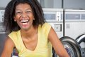 Cheerful woman in laundry portrait of african american Stock Photo