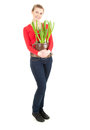 Cheerful woman with plant in pot, full lenght Stock Photo