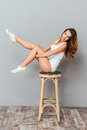 Cheerful woman sitting on the chair with raised legs Royalty Free Stock Photo
