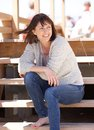 Cheerful woman sitting outdoors on steps portrait of a Royalty Free Stock Photography