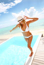 Cheerful woman standing by pool beautiful in bikini enjoying time Stock Photography