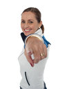 Cheerful woman standing sideways and pointing at you Stock Photography