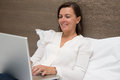 Cheerful woman using her laptop Royalty Free Stock Photo