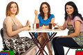 Cheerful women eating dessert at table Royalty Free Stock Image