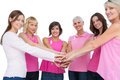 Cheerful women posing in circle holding hands looking at camera Royalty Free Stock Photo