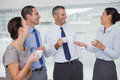 Cheerful work team during break time in bright office Royalty Free Stock Image