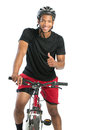 Cheerful Young African American Male Riding Bike