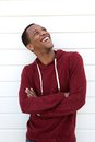 Cheerful young african american man portrait of a laughing and looking up Stock Images