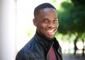 Cheerful young african american man smiling outside Royalty Free Stock Photo