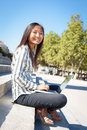 Cheerful young asian girl working on laptop happy using a sitting stairs in a park Stock Photos
