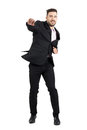 Cheerful young bearded business man jumping excited with clenched fists full body length portrait isolated over white studio Royalty Free Stock Photo