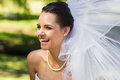 Cheerful young beautiful bride in park close up of a the Royalty Free Stock Photo