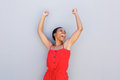 Cheerful young black woman with arms raised Royalty Free Stock Photo
