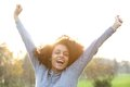 Cheerful young black woman smiling with arms raised portrait of a Royalty Free Stock Photos