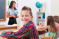 Cheerful young boy in school Royalty Free Stock Image
